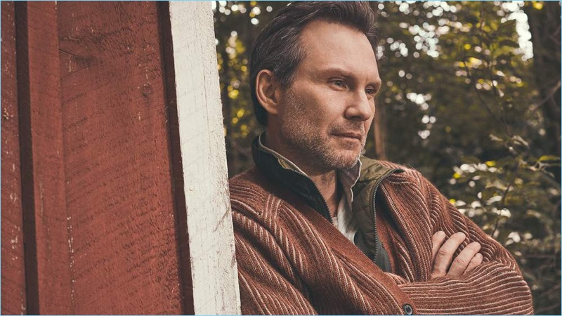 Connecting with Mr Porter, Christian Slater wears a Lanvin cardigan, Pataonia vest, Mollusk shirt, and Holiday Boileau t-shirt.