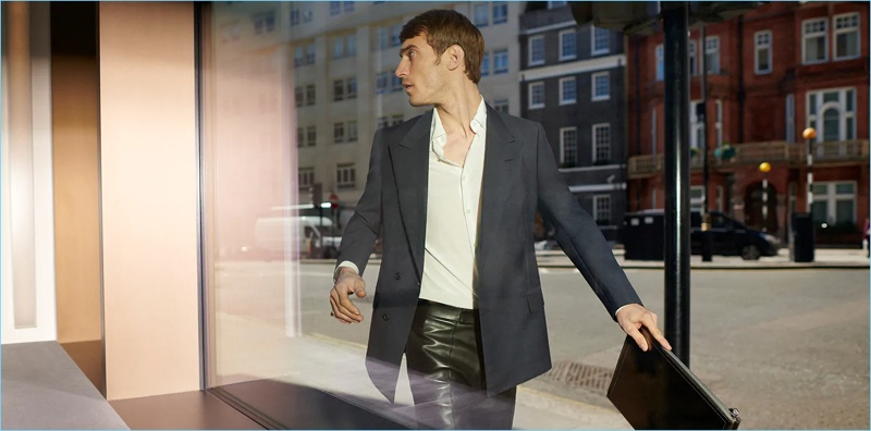 Donning leather pants, Clément Chabernaud appears in Dunhill's fall-winter 2018 campaign.