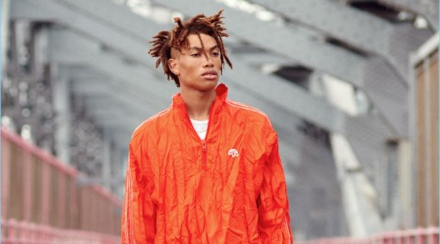 Embracing monochromatic style, Seth Hill wears a Sunspel tee with a windbreaker, pants, and sneakers from Adidas Originals by Alexander Wang.