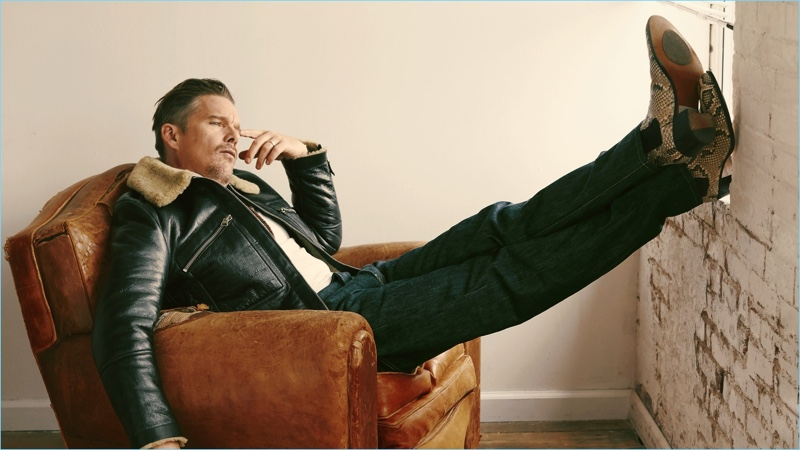Ethan Hawke wears a leather Tom Ford jacket, Ermenegildo Zegna Couture turtleneck, and Levi's Vintage Clothing jeans. He sports Tom Ford boots as well.