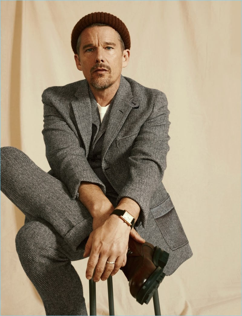 Connecting with GQ, Ethan Hawke wears a coat, vest, and pants by Ralph Lauren. A Levi's Vintage Clothing t-shirt, Dsquared2 boots, BOSS beanie, and Cartier watch complete his look.