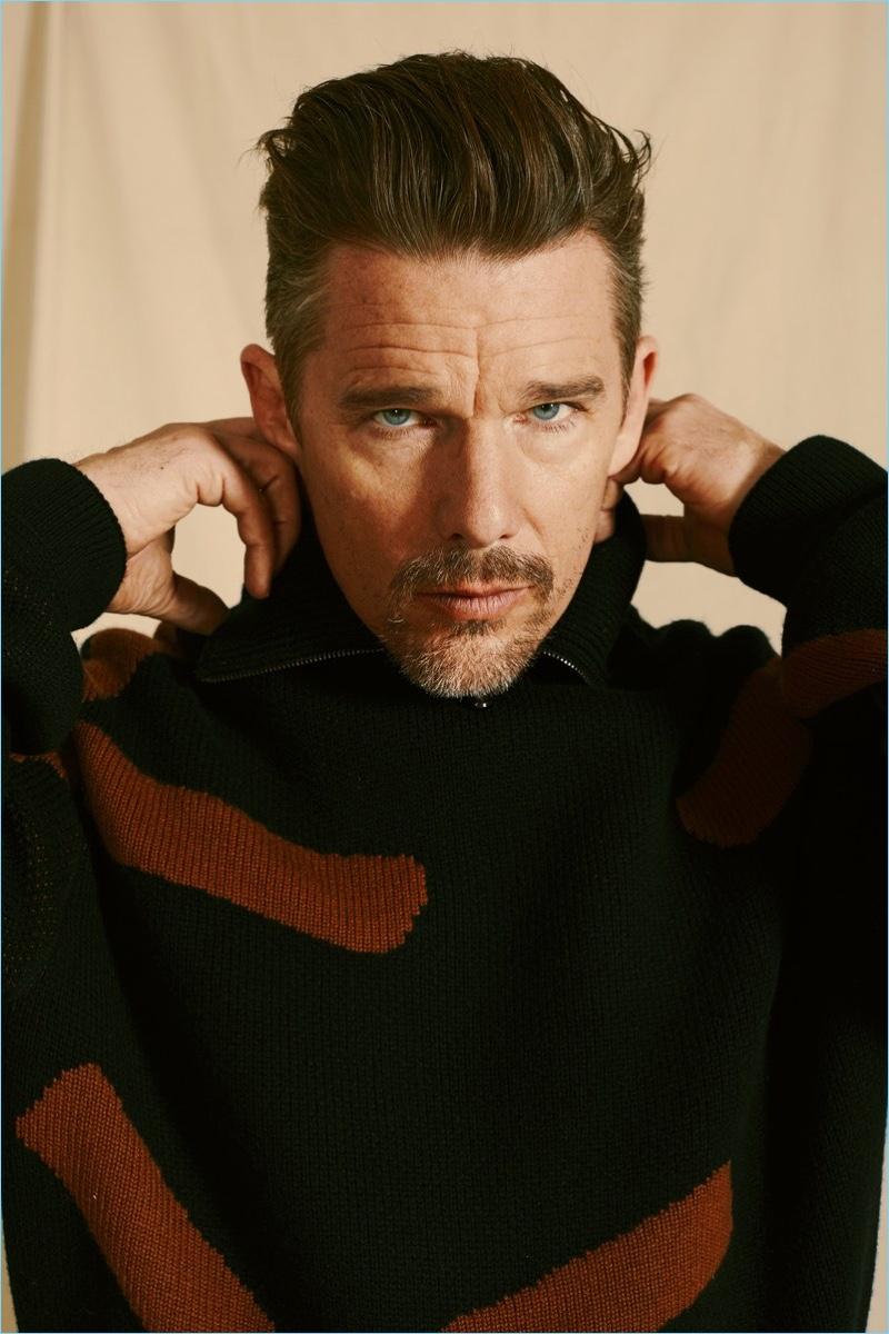 Starring in a photo shoot, Ethan Hawke dons an Ermenegildo Zegna Couture sweater.