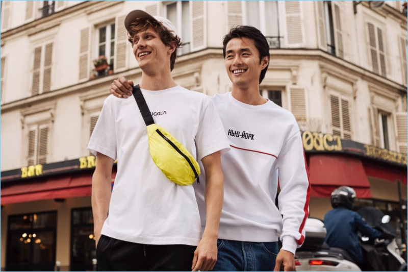 Models Felix Gesnouin and Zhao Lei sports fashions from H&M. Felix wears one of the brand's trendy belt bags.