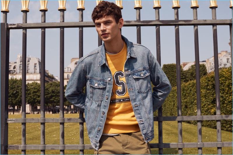 French model Arthur Gosse keeps it casual in a H&M denim jacket.