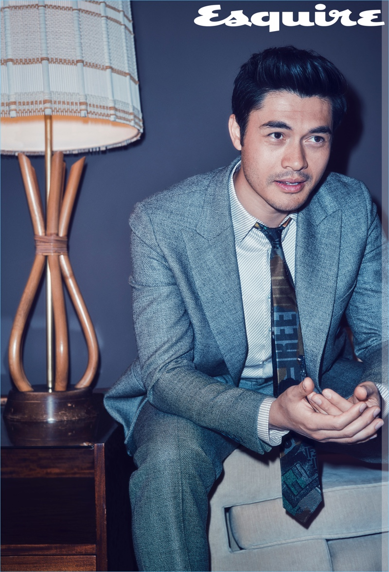 Actor Henry Golding sports a shirt, suit, and tie by Fendi.