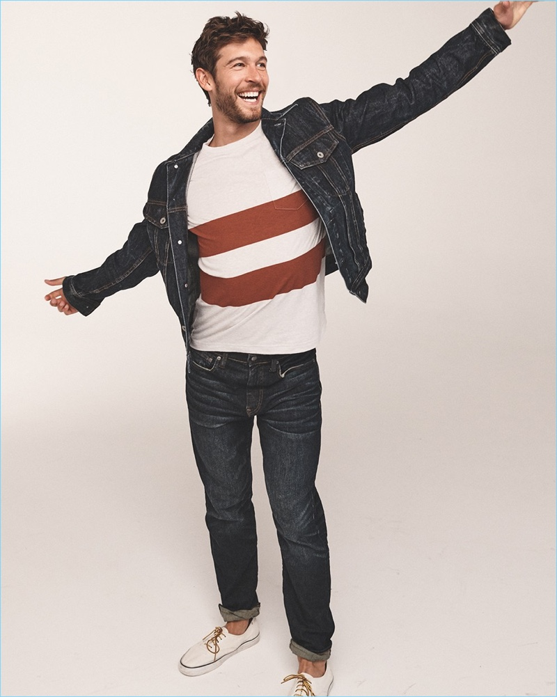 Josh Upshaw models a J.Crew classic denim jacket, double stripe t-shirt, and 770 straight-fit jeans with Vans sneakers.