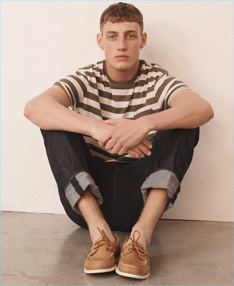 Soft Striped Tees: Aubrey O'Mahony models a J.Crew broken-in striped t-shirt, 770 straight-fit jeans in Japanese denim, and Sperry boat shoes.