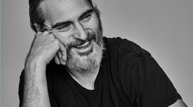 Actor Joaquin Phoenix sits for a black and white portrait.