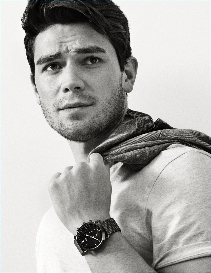 Actor KJ Apa dons the Fossil Hybrid Smartwatch Q Commuter in stainless steel.