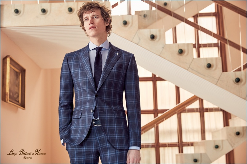 Model Marçal Taberner is front and center in a blue suit from Luigi Bianchi Mantova's fall-winter 2018 collection.