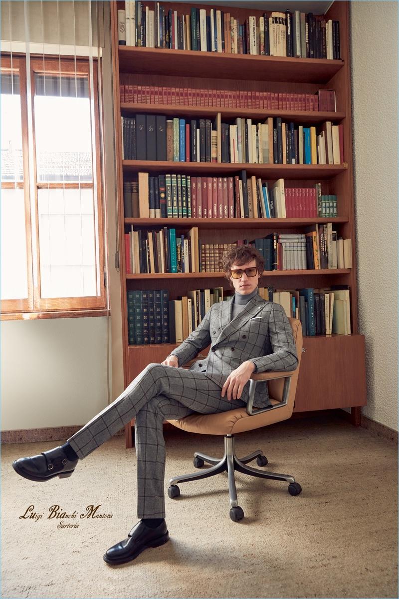Marçal Taberner wears a windowpane suit in grey by Luigi Bianchi Mantova.