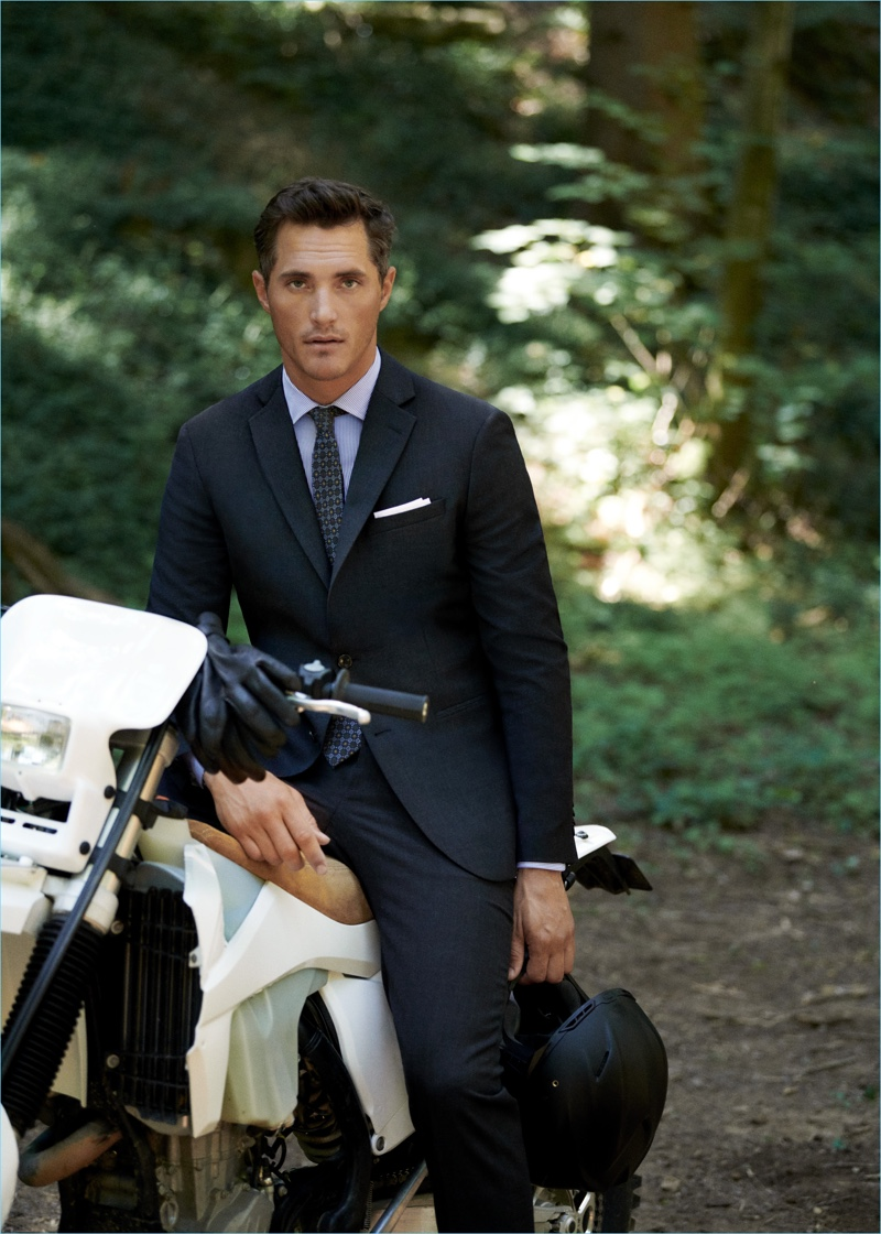 British model Ollie Edwards wears Mango Man's travel suit in navy check.