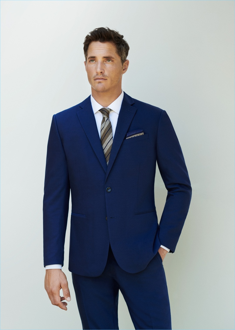 Front and center, Ollie Edwards sports Mango Man's travel suit in Prussian blue.