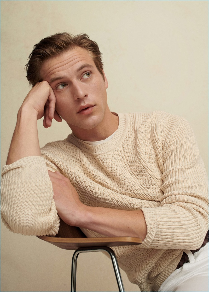 Jules Raynal wears a cable-knit sweater from Mango Man.