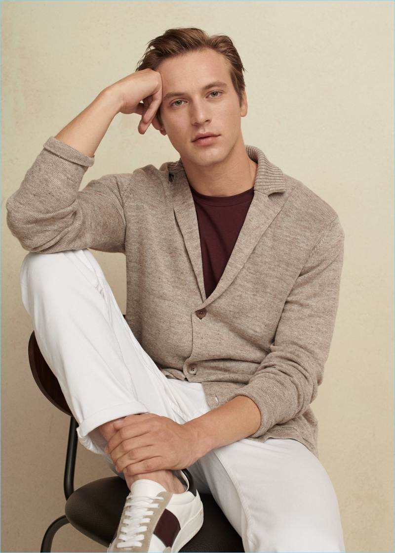 A smart vision, Jules Raynal sports a Mango Man cardigan, tee, pants, and sneakers.