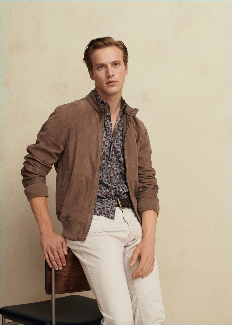 French model Jules Raynal dons a brown suede bomber, printed shirts, and white jeans from Mango Man.