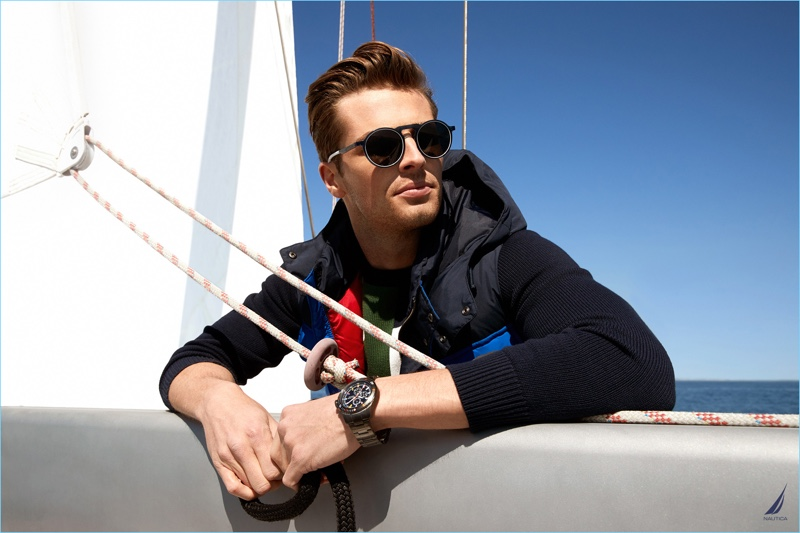 British model Edward Wilding dons sunglasses and a watch for Nautica's fall-winter 2018 campaign.