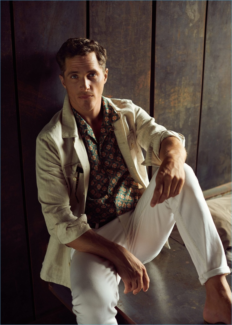 Ollie Edwards dons a linen-blend jacket and white jeans with a printed shirt by Mango Man.