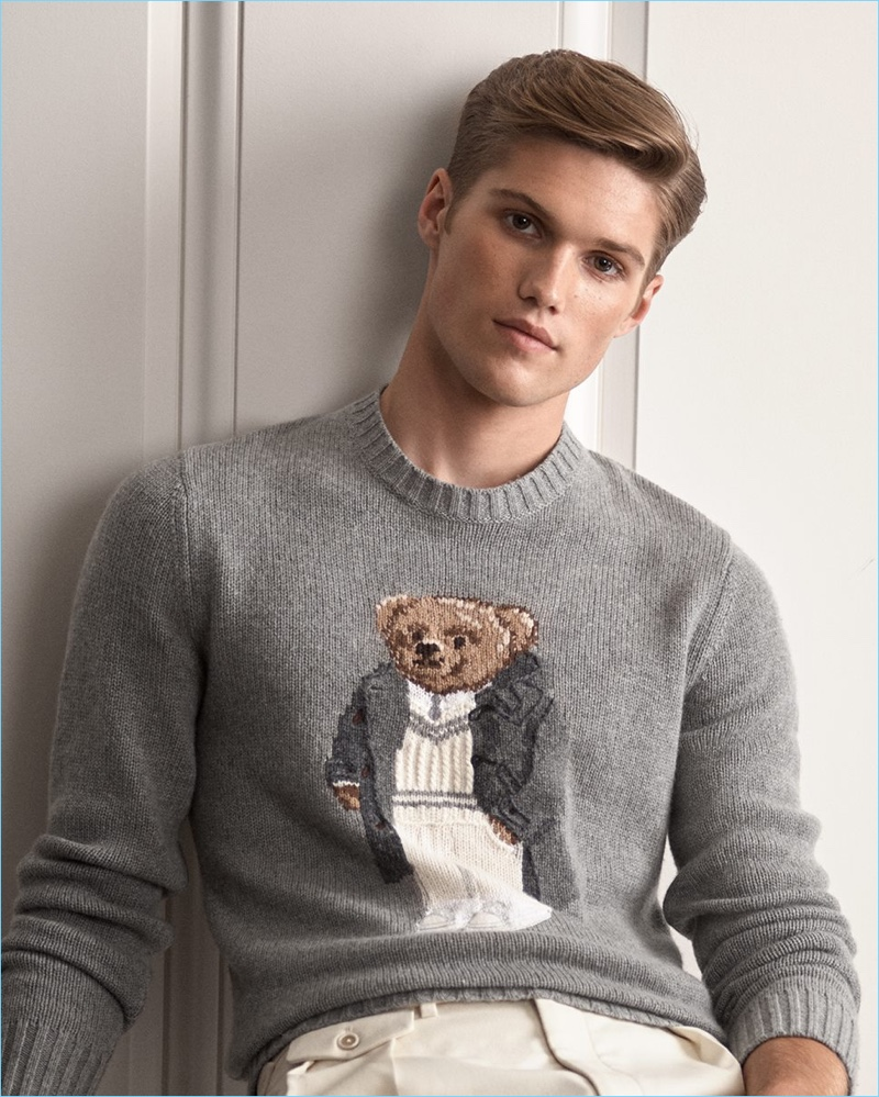 Front and center, Nick Truelove sports Ralph Lauren Purple Label's iconic Polo Bear sweater.