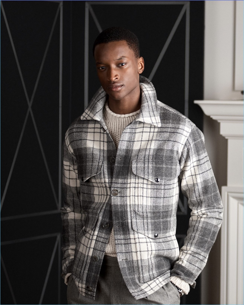 Oliver Kumbi dons a plaid wool tweed jacket from Ralph Lauren Purple Label.
