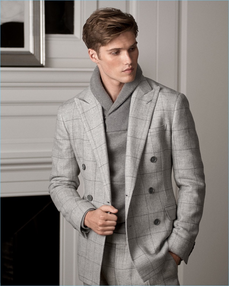 Embracing shades of grey, Nick Truelove dons a windowpane print suit with a shawl collar sweater from Ralph Lauren Purple Label.