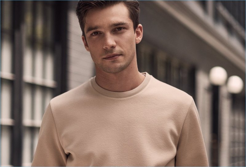 Sweater Weather: Alexis Petit dons a camel sweater from Reiss.