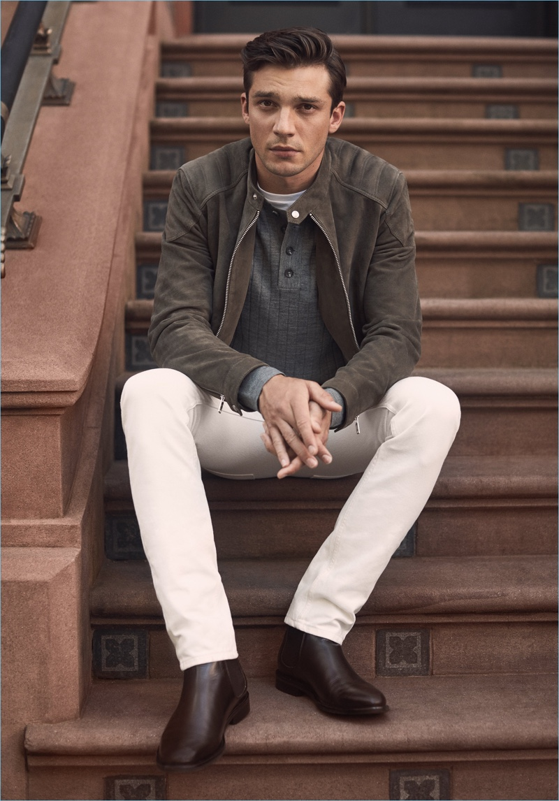 A Shade of Suede: Alexis Petit wears a Reiss suede quilted jacket, ribbed henley, white jeans, and leather boots.