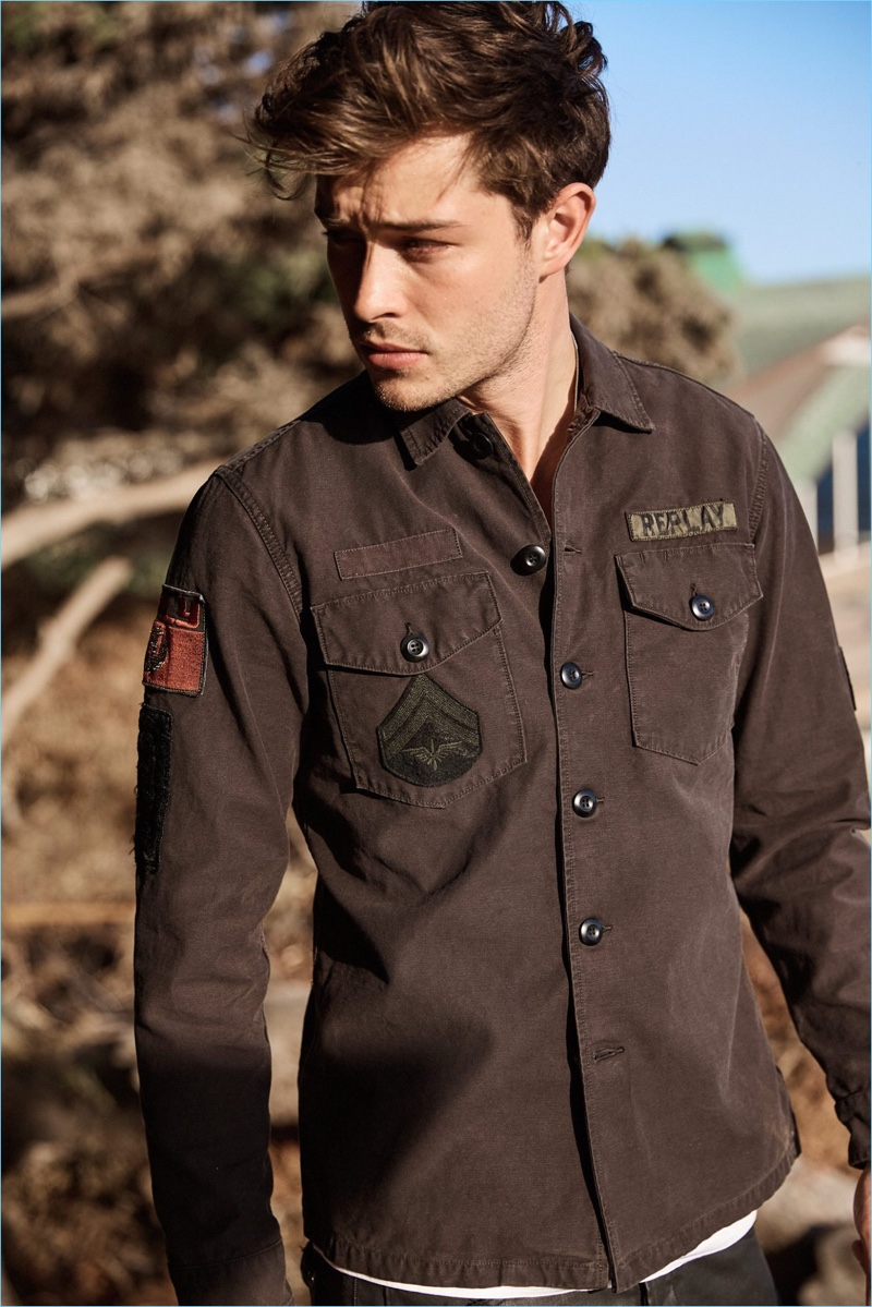 Model Francisco Lachowski sports a patched shirt from Replay.