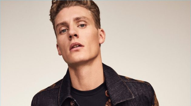 Front and center, Mikkel Jensen rocks an embroidered denim jacket and t-shirt with jeans from River Island's RI30 collection.