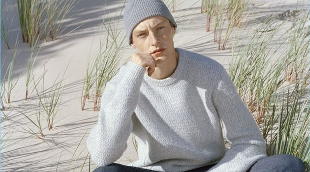 A smart vision, Roberto Sipos wears a sweater and slim-fit jeans.