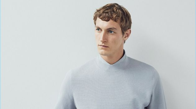 A smart vision, Rutger Schoone wears a COS mock-neck knitted sweater and cotton shirt.