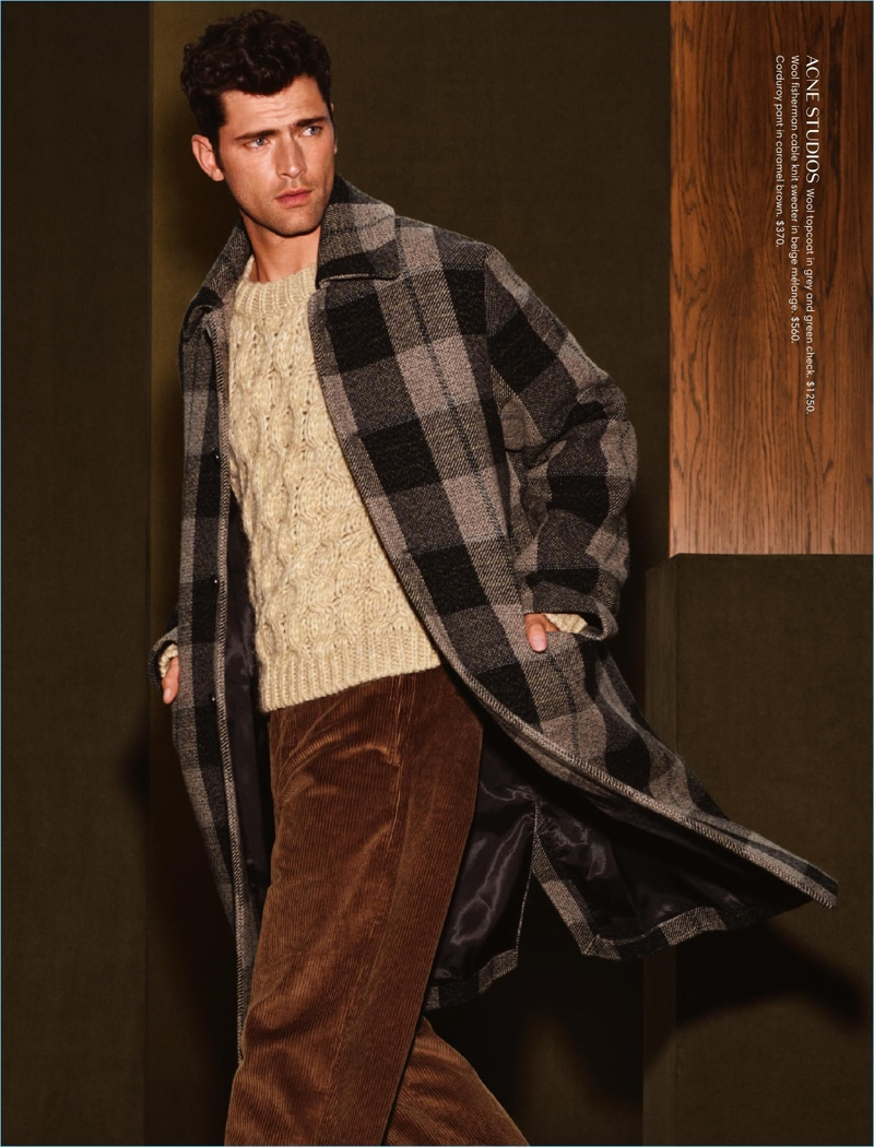 Dashing; to say the least, Sean O'Pry wears a plaid Acne Studios coat.