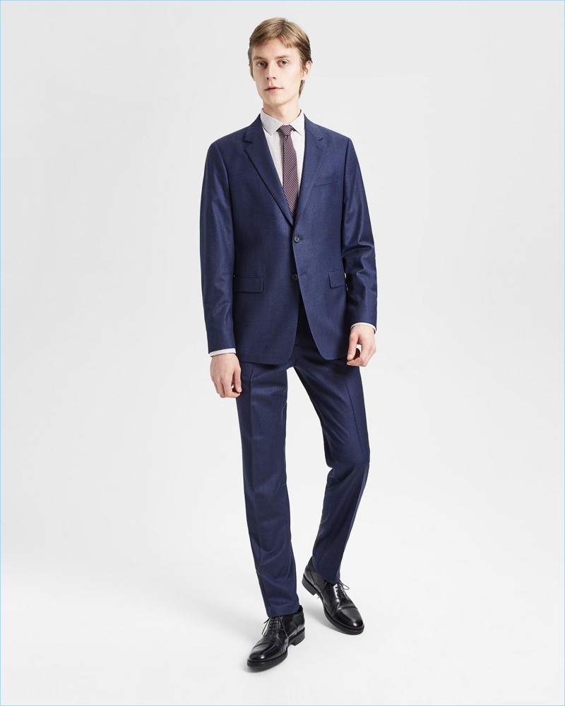 Front and center, Janis Ancens sports Theory's Good Wool suit in admiral blue.