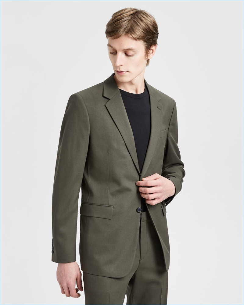 Model Janis Ancens dons Theory's Good Wool suit in military green.