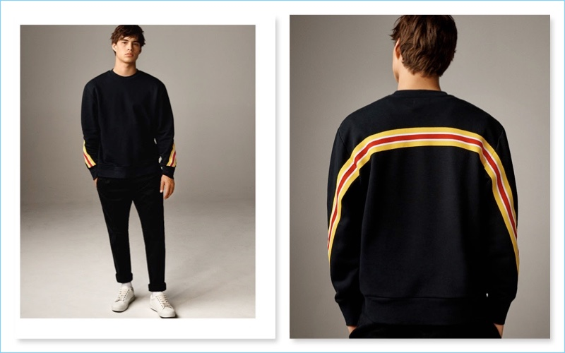 Playing it casual, Louis Baines wears black taping sweater with white lace sneakers from Topman.