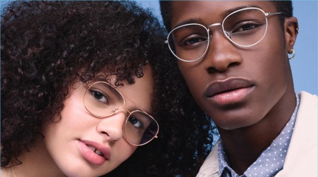Pictured right, James Kakonge models Warby Parker Hawkins glasses in antique silver.