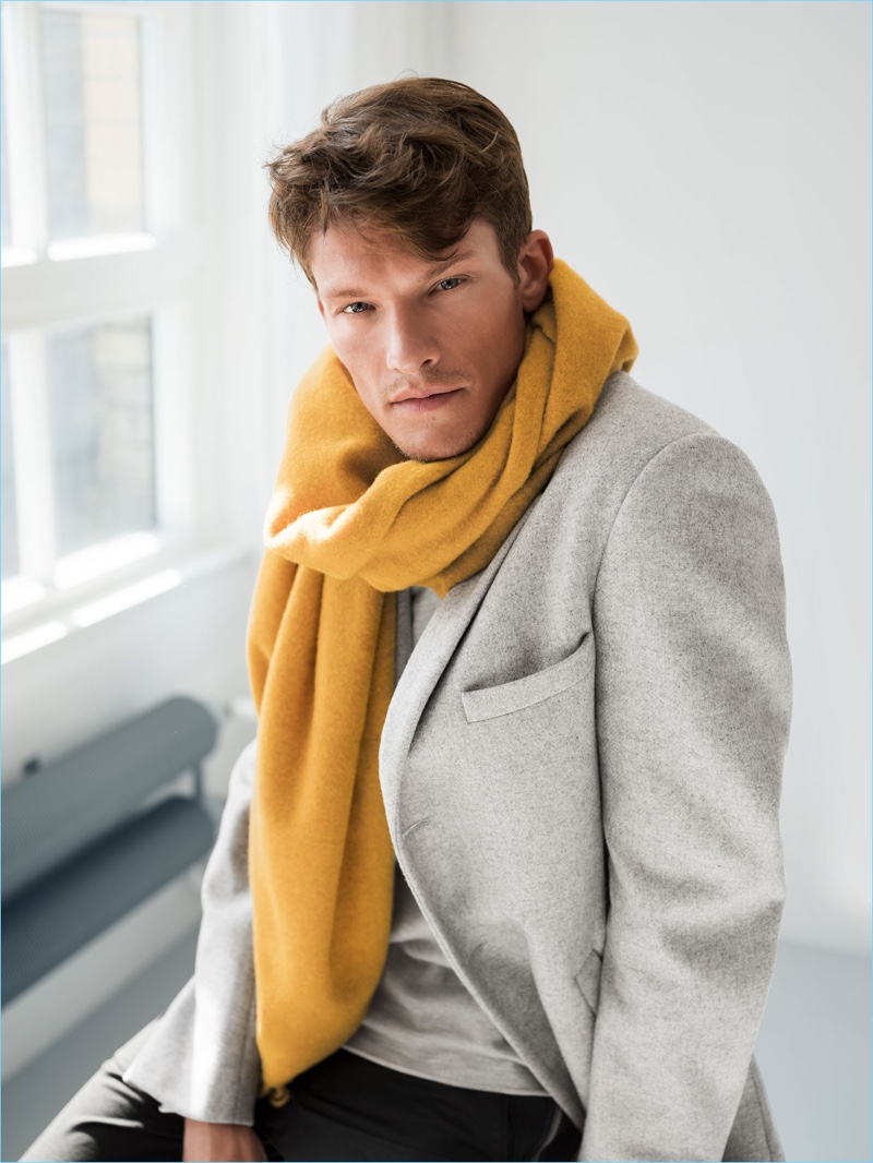 Sporting a yellow scarf and pale grey blazer, Danny Beauchamp appears in Wormland's fall-winter 2018 campaign.