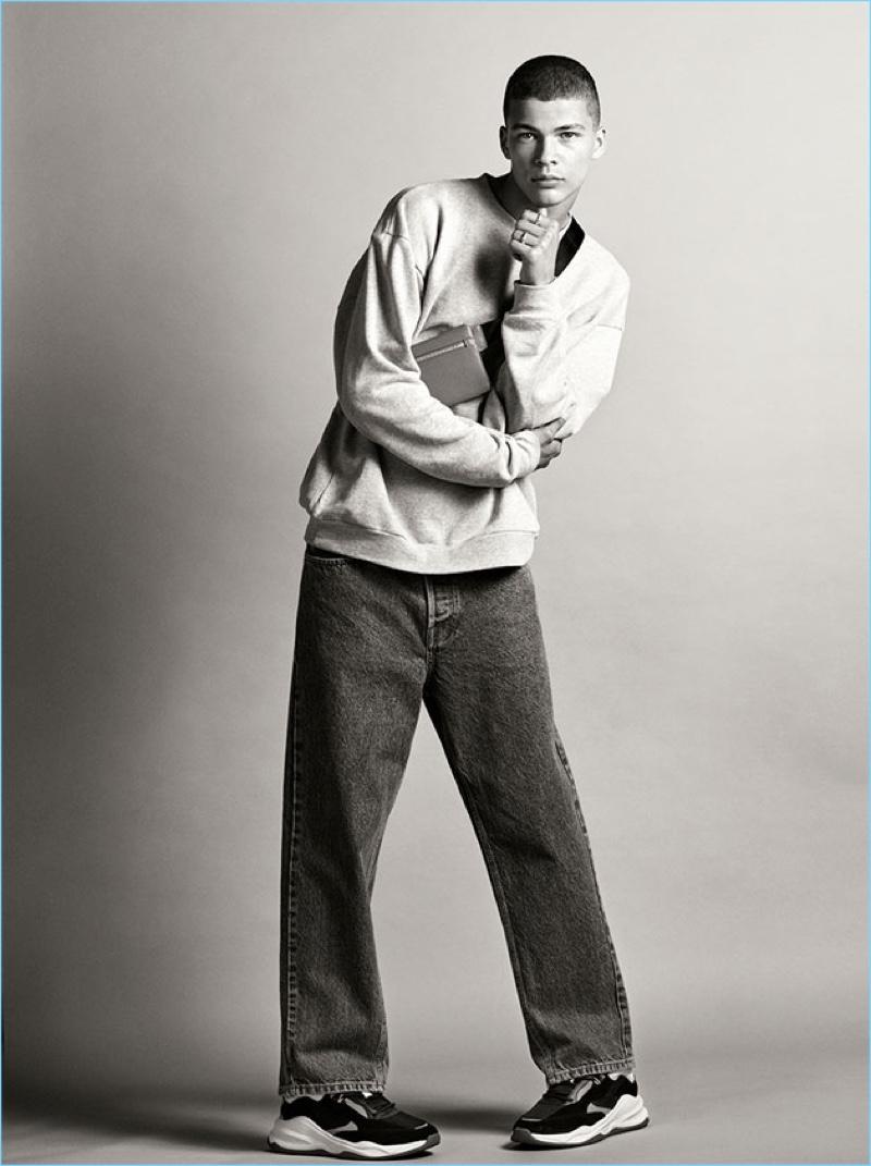 Leonard Mushiete wears essential denim jeans from Zara Man.