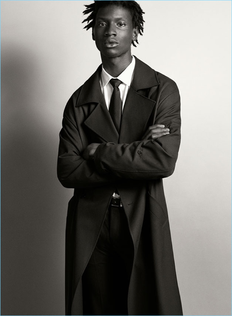 Adonis Bosso wears a classic trench from Zara Man.