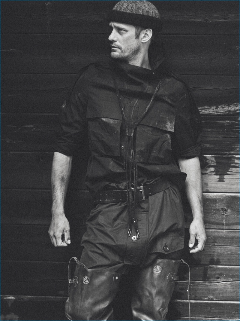 Starring in a new photo shoot, Alexander Skarsgård wears a Craig Green top, vintage Cassie Mercantile pants, Early Halloween boots, and vintage accessories.