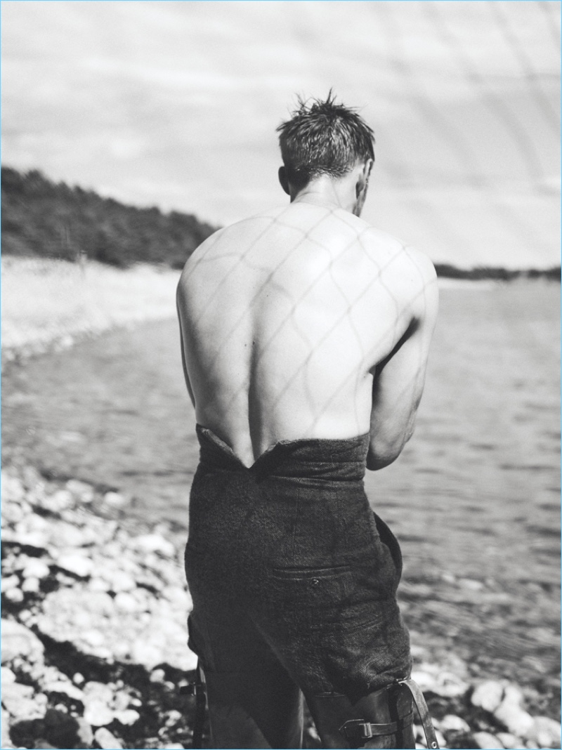 Turning his back to the camera, Alexander Skarsgård wears Rick Owens pants.