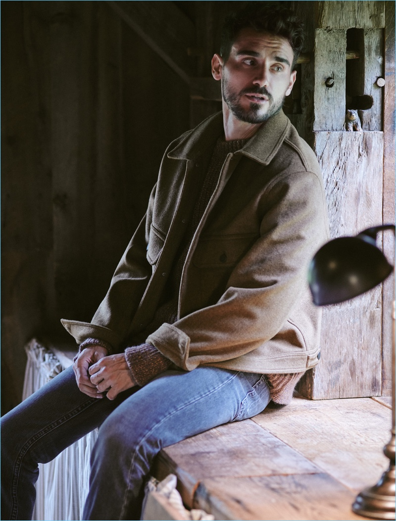 Sporting fall fashions, Arthur Kulkov wears a Lemaire blouson jacket and sweater with Helmut Lang jeans.