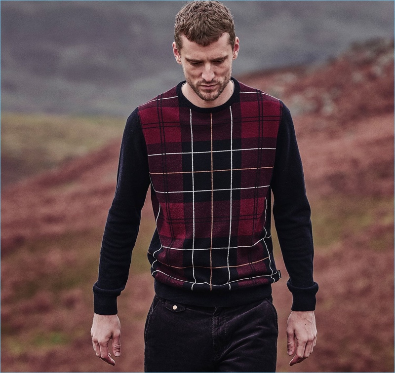 George Barnett dons a plaid sweater from Barbour's fall-winter 2018 tartan collection.