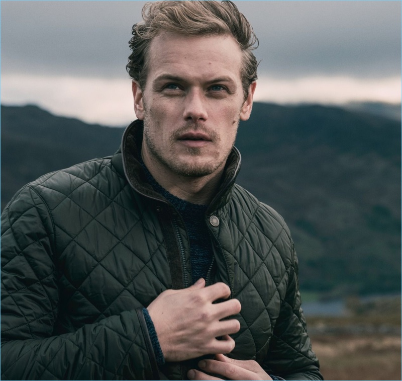 Outlander star Sam Heughan wears a quilted jacket from Barbour.