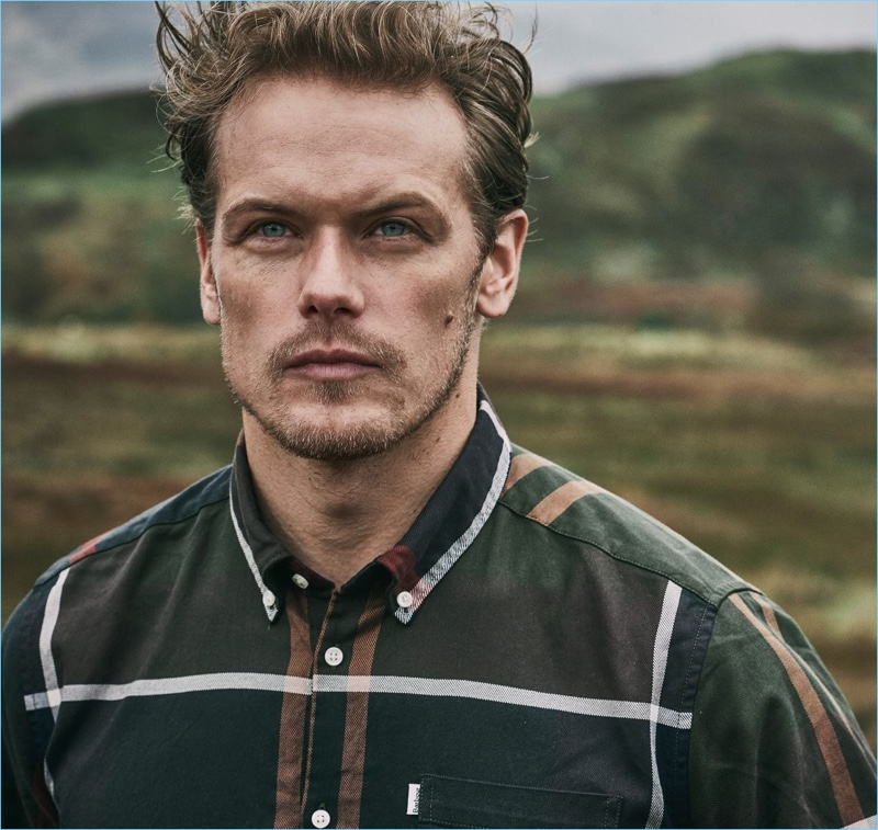 Actor Sam Heughan sports a plaid shirt from Barbour's fall-winter 2018 tartan collection.