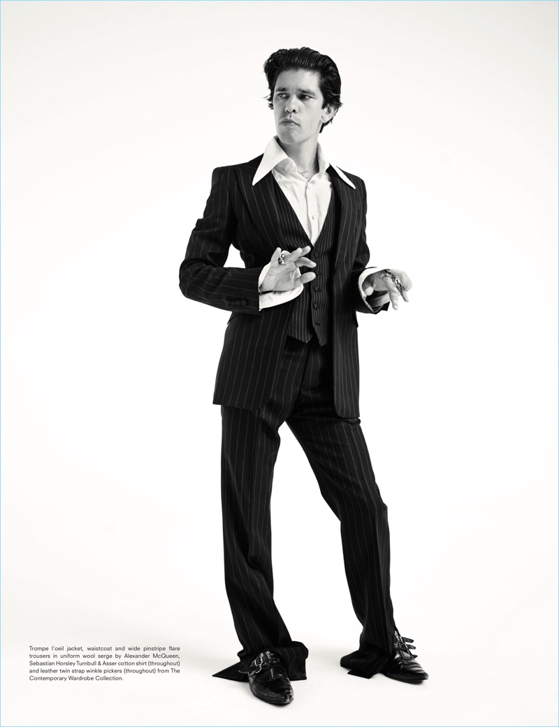 Front and center, Ben Whishaw dons a pinstripe suit from Alexander McQueen with a Turnbull & Asser shirt.