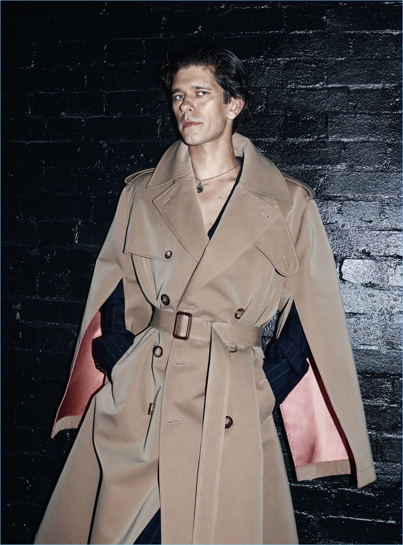 A chic vision, Ben Whishaw wears an Alexander McQueen double-breasted trench coat.