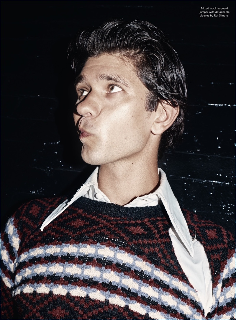 Making a silly face, Ben Whishaw wears a Raf Simons sweater.