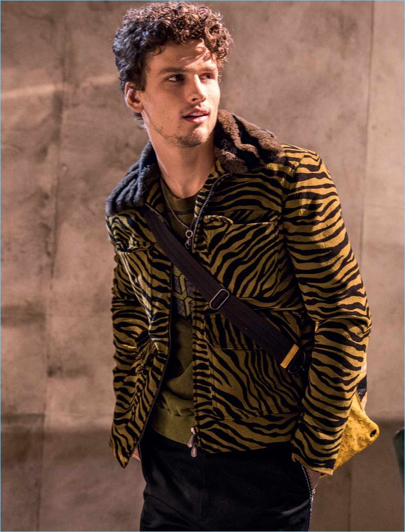 Simon Nessman sports a tiger print jacket from Bottega Veneta's fall-winter 2018 collection.