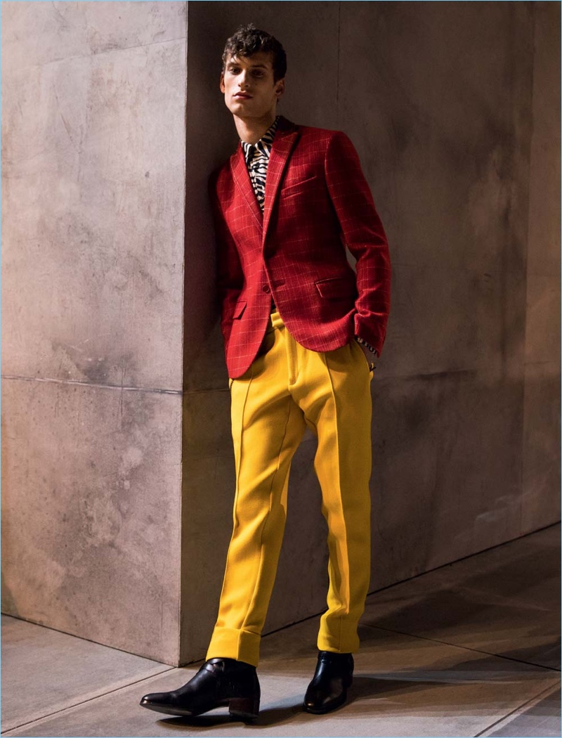 David Trulik sports colorful suiting separates from Bottega Veneta's fall-winter 2018 collection.